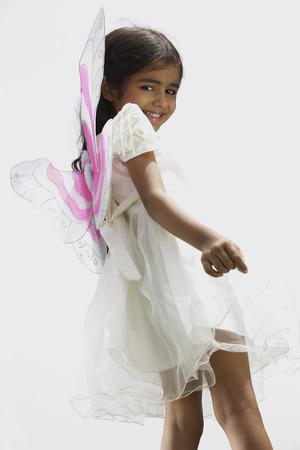 Little girl wearing wings