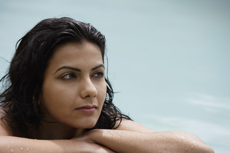 young woman resting poolside
