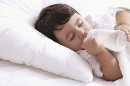 european ethnicity: baby boy, asleep with bottle LANG_EVOIMAGES