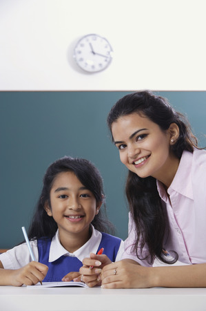 librarians: teacher and student smile at camera (close up)