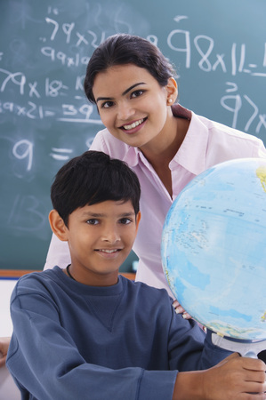 librarians: teacher and student with globe