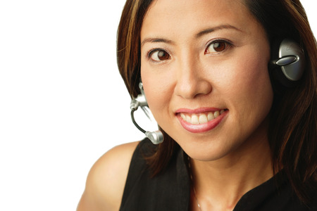 hands free phone: Woman using headset, portrait