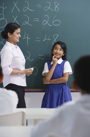 librarians: teacher and girl at chalkboard