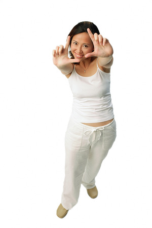 Woman making hand sign, looking at camera