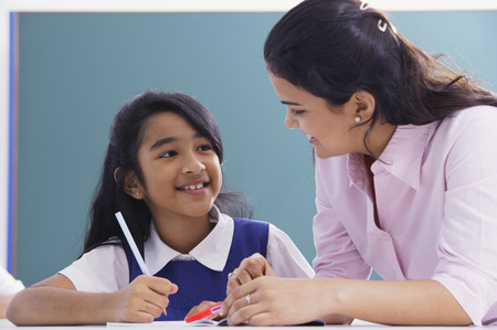 librarians: teacher and student smile at each other