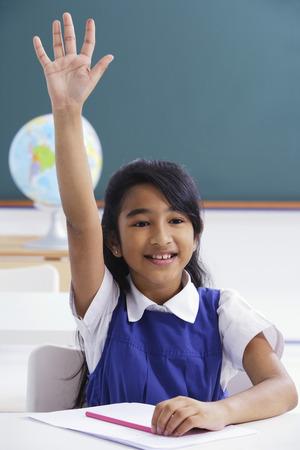 raises: girl raises hand in class