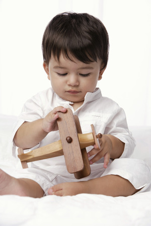 european ethnicity: baby boy playing with toy airplane