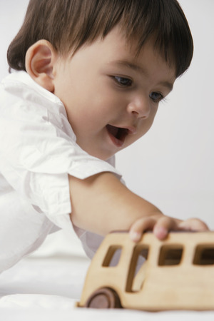 european ethnicity: baby boy playing with toy auto LANG_EVOIMAGES