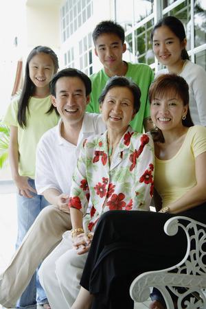 three generation: Three generation family smiling at camera