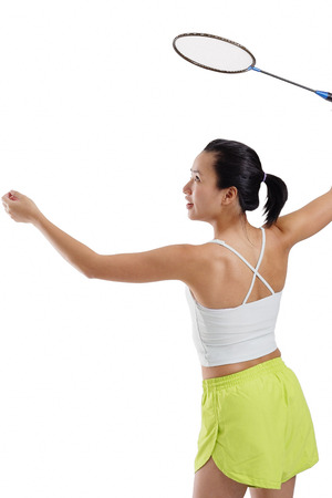 vietnamese ethnicity: Woman holding badminton racket, about to serve