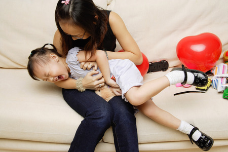 3 4 years: Mother tickling daughter