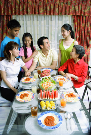 three generation: Three generation family at dining table LANG_EVOIMAGES