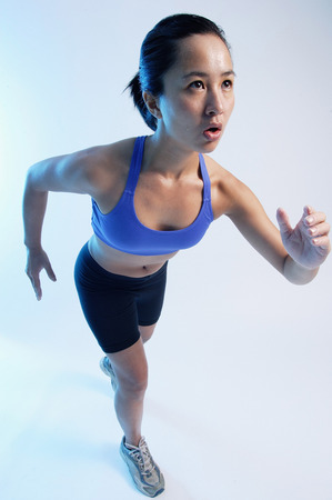 vietnamese ethnicity: Woman in running position, high angle view