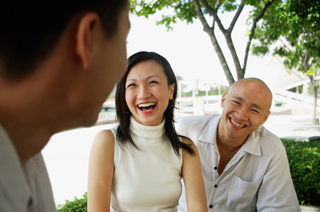 adults: Young adults laughing, portrait