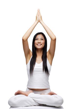 Woman practicing yoga, smiling