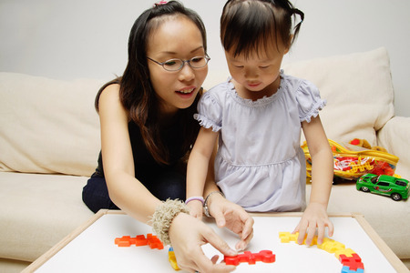 3 4 years: Mother and daughter, playing with toys
