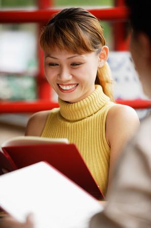 Couple looking at menus