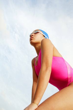 vietnamese ethnicity: Woman in swimming costume, looking away, low angle view