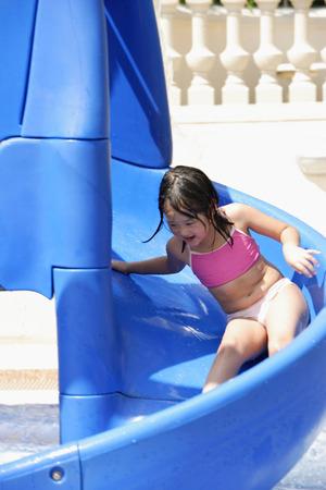 ウォーター スライドで遊ぶ女の子 写真素材