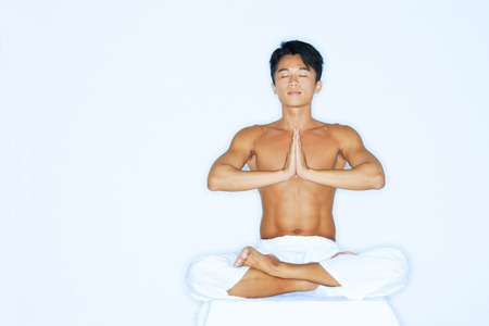 Man practicing yoga, meditating Stock Photo