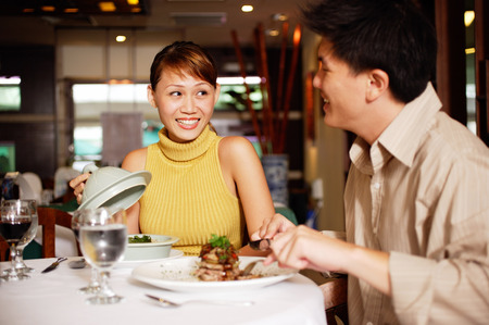 Couple in restaurant, dining LANG_EVOIMAGES