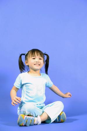 crosslegged: Girl sitting cross-legged, smiling
