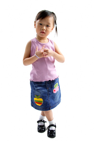 3 4 years: Young girl standing, looking at camera