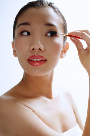 in vain: Woman applying eye shadow