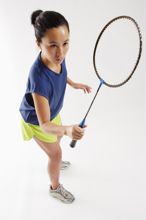 vietnamese ethnicity: Woman holding badminton racket, high angle view LANG_EVOIMAGES