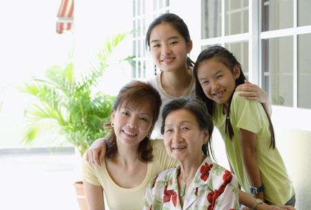 three generations of women: Three generation family, looking at camera, smiling