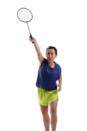 vietnamese ethnicity: Woman holding badminton racket up