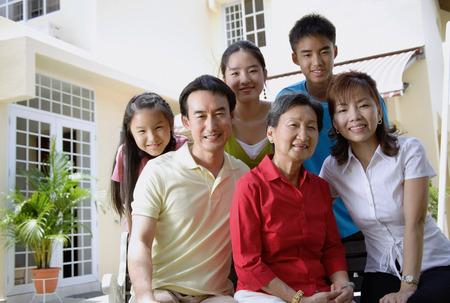 Three generation family, looking at camera, portrait Stock Photo - 69310548