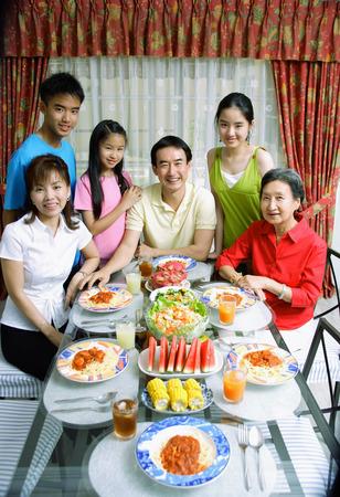 three generation: Three generation family around dining table, portrait