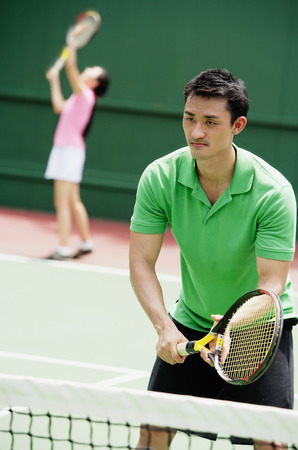 Couple playing tennis, mixed doubles Stock Photo