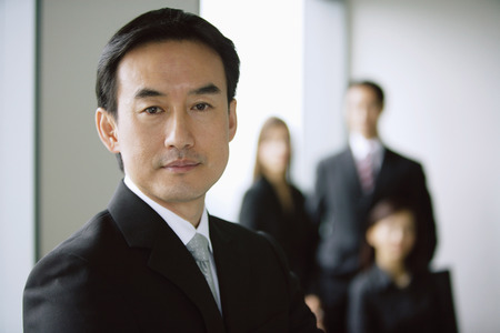 mature business man: Businessman, portrait, people in the background