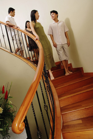adults: Young adults walking down stairs