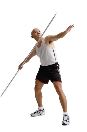 Young man preparing to throw javelin Stok Fotoğraf