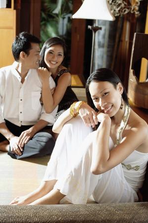 adults: Young adults smiling at camera