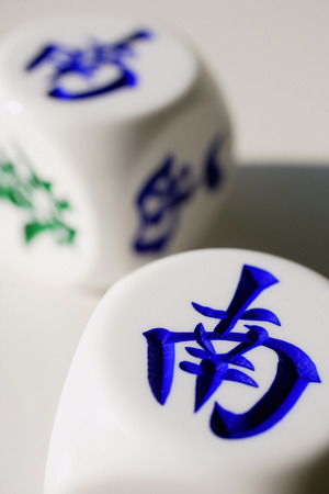 Two Chinese dice with the words South