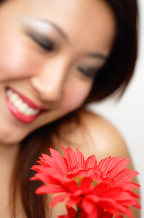 focus in foreground: Woman with flower, focus on the foreground