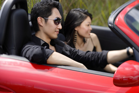 transportation: Couple in convertible sports car LANG_EVOIMAGES