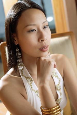 half dressed: Woman looking away, hand on chin