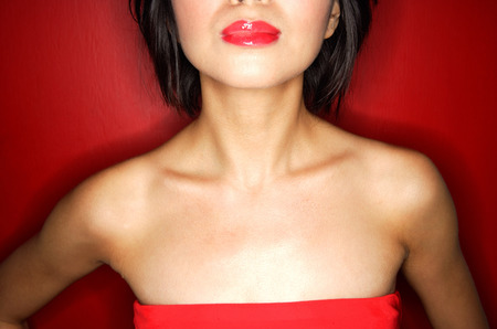 red tube: Woman in red tube tope with red lipstick LANG_EVOIMAGES