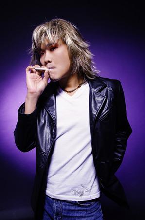 leather jacket: Man in leather jacket, smoking LANG_EVOIMAGES