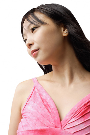 Woman in pink tank top, looking way, head shot LANG_EVOIMAGES