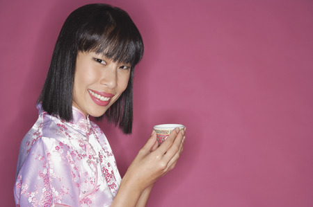 Woman holding Chinese tea cup Stock Photo