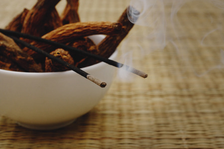 Bowl of incense sticks