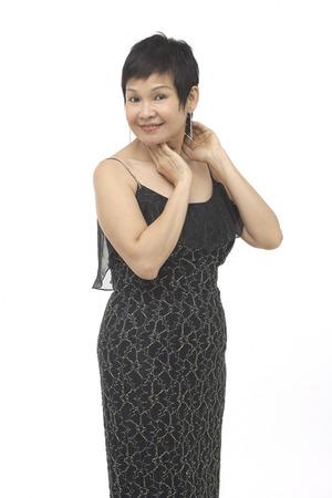 Mature woman in black dress, portrait
