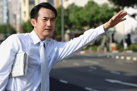 Businessman flagging a cab