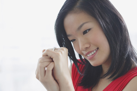 Woman looking at ring on her finger